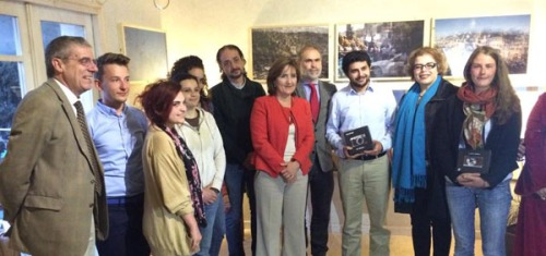 Participants in the fifth annual Image Festival photography competition pose for a photo with French Ambassador to Jordan Caroline Dumas at an exhibition last Wednesday (Photo by Hind Joucka)